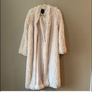 Teddy coat in a subtle blush pink